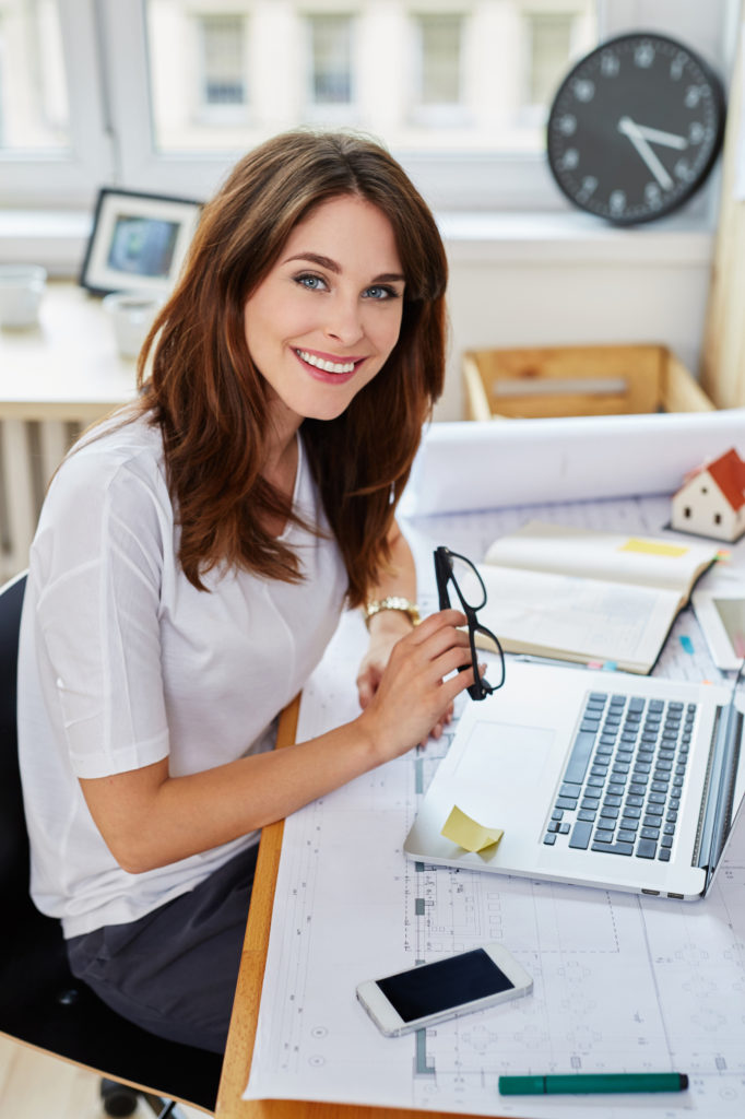 Businesswoman, architect sitting at a desk at the office